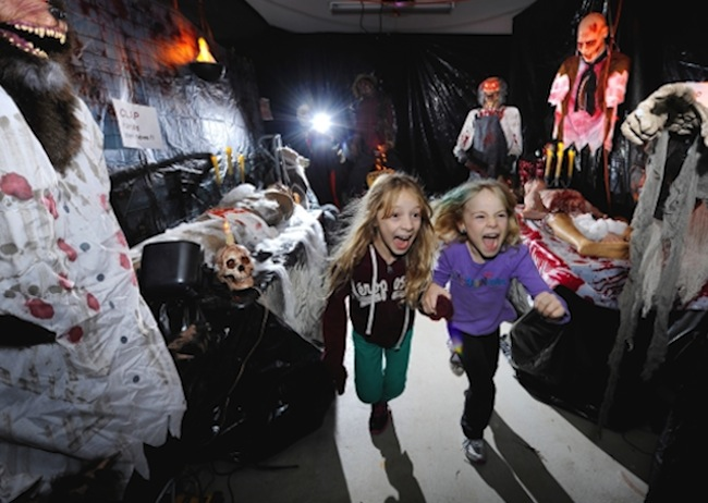 Kids having scary fun in a haunted house.