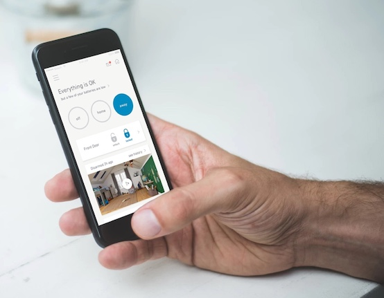 Person interacting with the SimpliSafe app on a cell phone